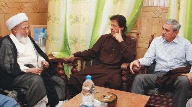 Imran Khan (C) meets with Sheikh Muhammad Hassan Jaffery (L) in Skardu, the main city in northern region of Gilgit–Baltistan, Pakistan, on September 2, 2012.