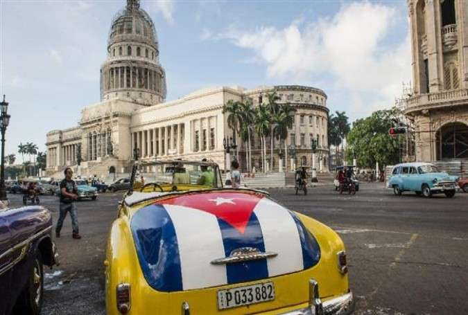 An old car with the Cuban flag painted on the trunk is seen near the Capitol of Havana, on January 7, 2015.