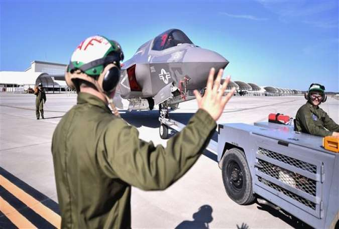 Ground crew maneuver the F-35 Lightning II fifth generation aircraft at the Marine Corps Air Station Beaufort, in Beaufort, South Carolina, March 8, 2016.