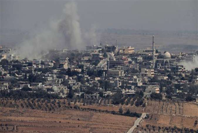 A picture taken from the Israeli-held Golan Heights on September 10, 2016 shows smoke rising from the Syrian village of Jubata al-Khashab after an Israeli aircraft struck Syrian army positions there.