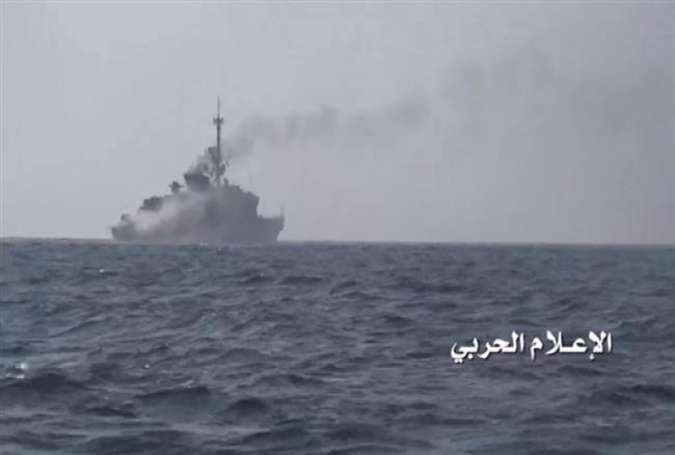 Smoke rises from al-Madinah warship in waters near the city of Hudaydah, Yemen, on January 30, 2017 after Yemeni army forces, backed by fighters from allied Popular Committees, fired a guided missile at it.