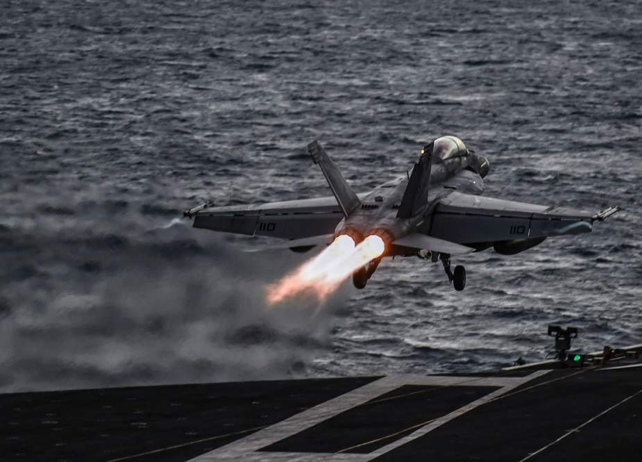 An F18 Hornet fighter jet pilot takes off from the deck of the US navy aircraft carrier USS Harry S. Truman in the eastern Mediterranean Sea on May 8, 2018. (Photo by AFP)