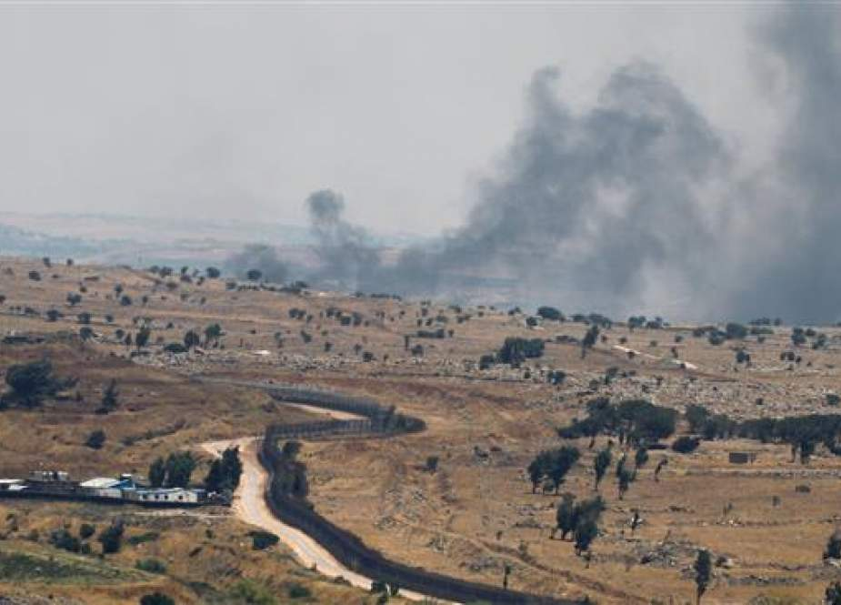 A picture taken from the Israeli-occupied Golan Heights shows smoke billowing from the Syrian side of the border on June 26, 2017. (Photo by AFP)