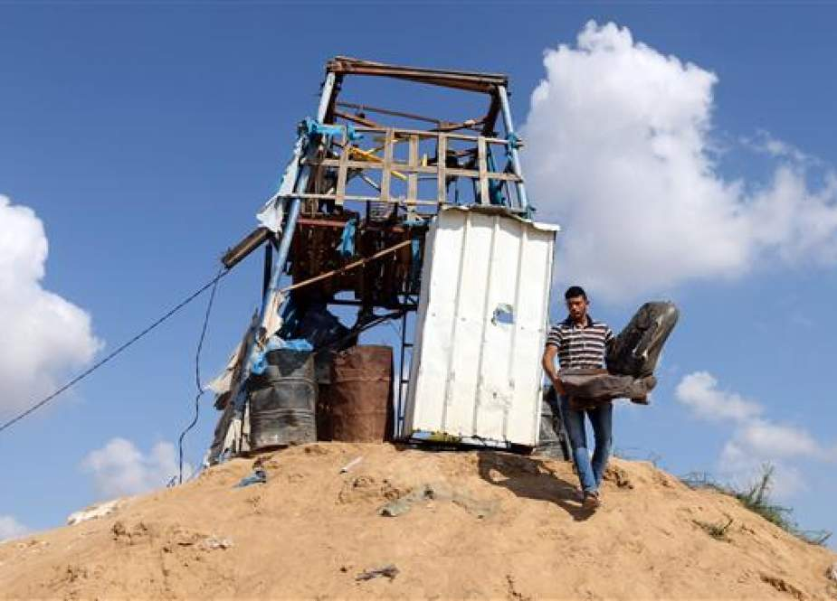A Palestinian man removes a chair at a Hamas observation post that was targeted in Israeli shelling, in Khan Younis in the southern Gaza Strip on July 21, 2018. (Photo by Reuters)