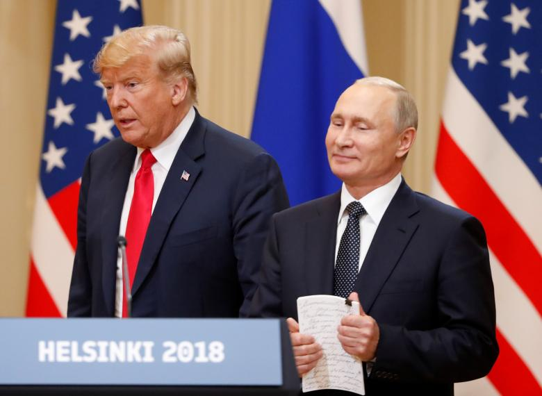 U.S. President Trump and Russian President Putin arrive for a joint news conference.