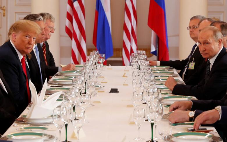 President Donald Trump participates in an expanded bilateral meeting with Russia's President Vladimir Putin.
