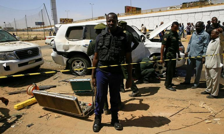 Security personnel stand near a car damaged after an explosion targeting the motorcade of Sudan's Prime Minister Abdallah Hamdok near the Kober Bridge in Khartoum, Sudan. Reuters