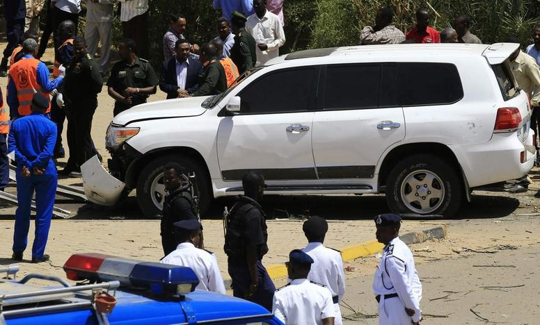 Sudanese rescue teams and security forces gather next to a damaged vehicle at the site of an assassination attempt against Sudan's Prime Minister Abdalla Hamdok, who survived the attack with explosives unharmed, in the capital Khartoum. AFP