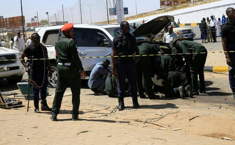 Security personnel stand near a car damaged after an explosion targeting the motorcade of Sudan's Prime Minister Abdalla Hamdok near the Kober Bridge in Khartoum, Sudan. Reuters