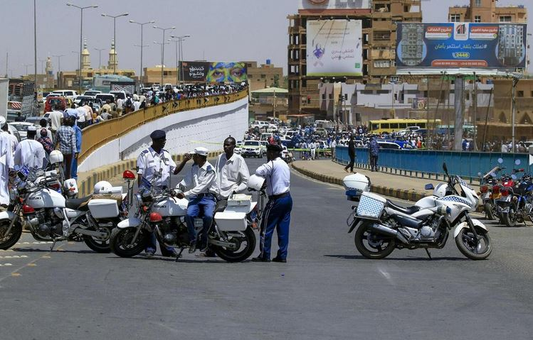 Sudanese security forces stand guard at the cordoned-off site of an assassination attempt against Sudan's Prime Minister Abdalla Hamdok, who survived the attack with explosives unharmed, in the capital Khartoum. AFP