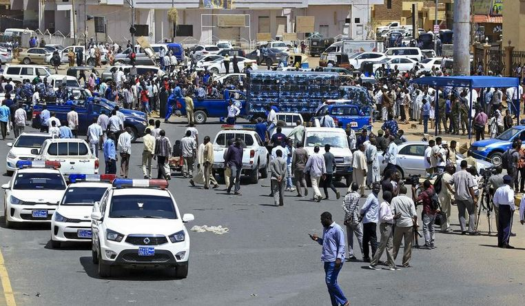 Sudanese rescue teams and security forces gather at the site of an assassination attempt against Sudan's Prime Minister Abdalla Hamdok, who survived the attack with explosives unharmed, in the capital Khartoum.