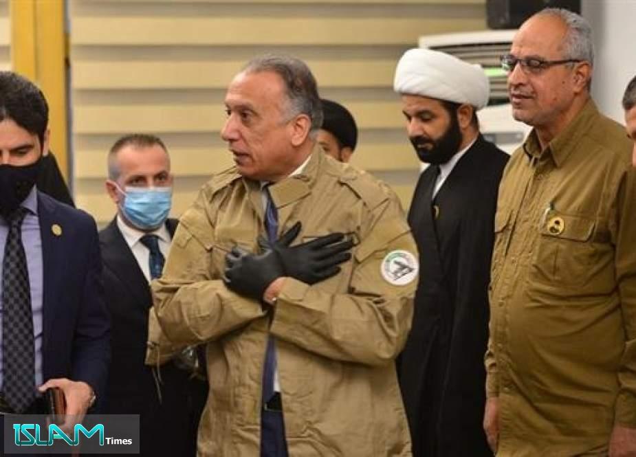 Iraqi PM Wears Hashd al-Sha