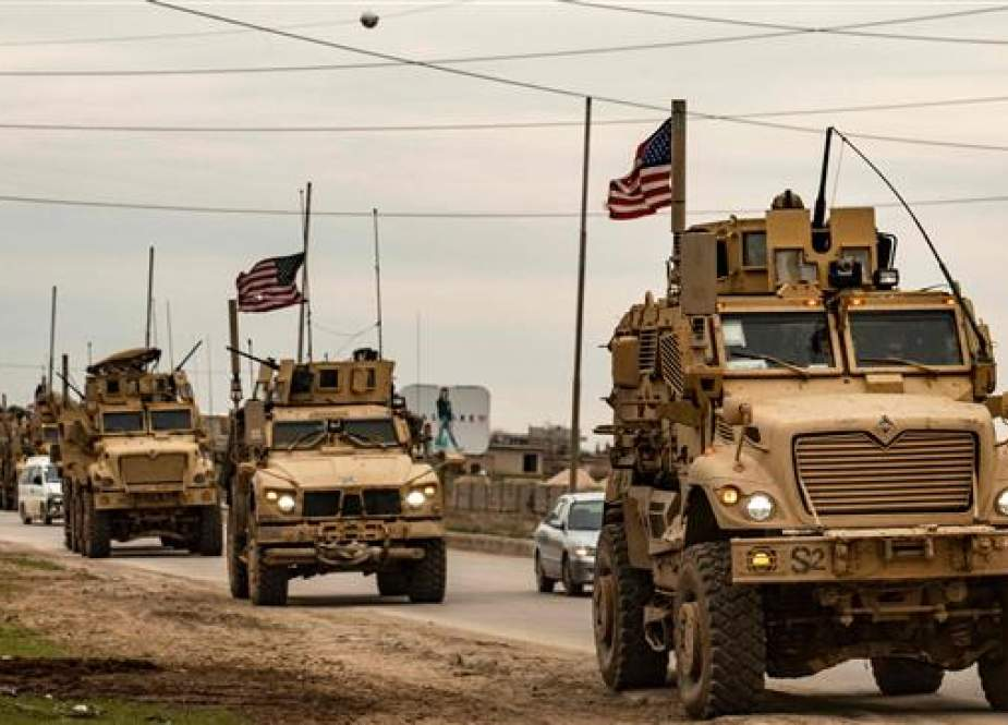 US military convoy drives on the outskirts of the Kurdish-controlled northern Syrian city of Qamishli.jpg