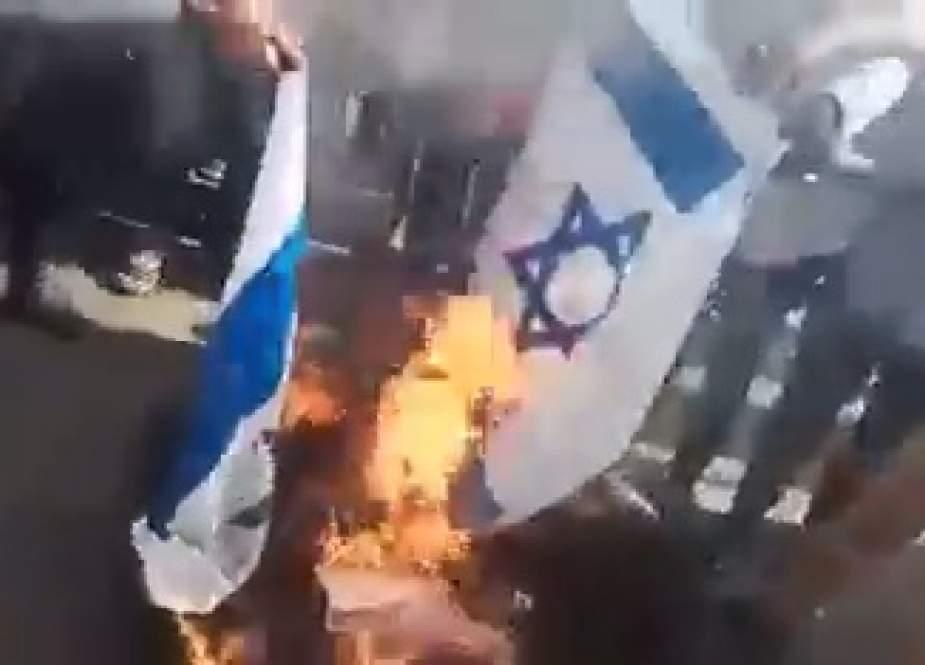 Sudanese are burning the Israeli flag.jpg
