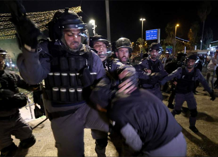 Israeli police scuffle with a Palestinian during clashes with Israeli police at Damascus Gate on Laylat al-Qadr during the holy month of Ramadan, in Jerusalem