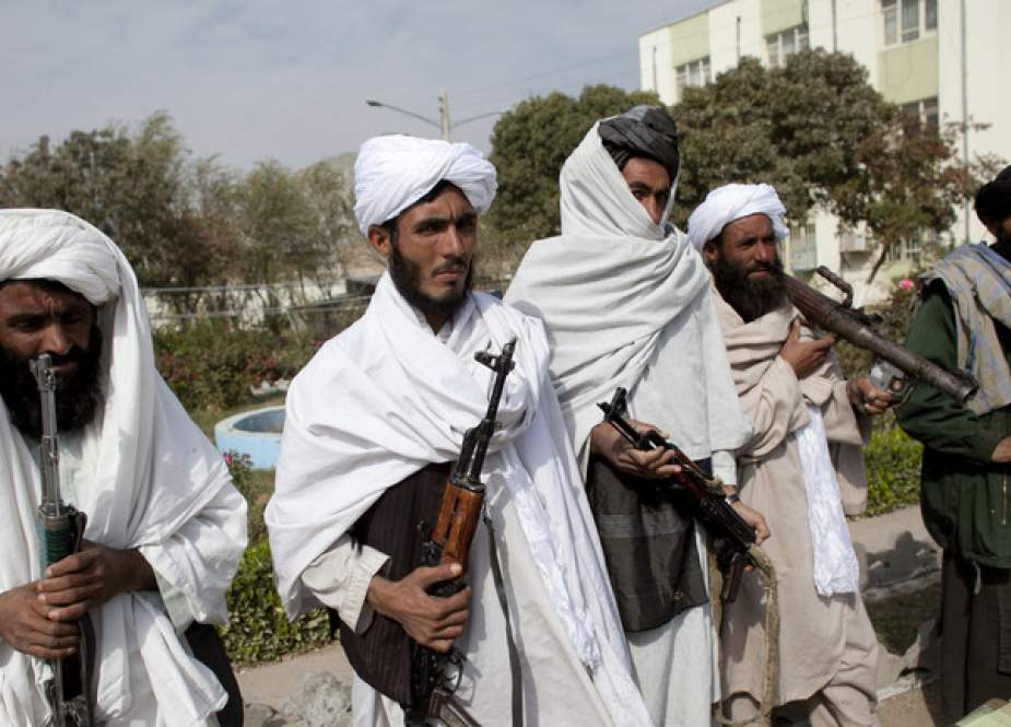 Surrendering Taliban militants stand with their weapons as they are presented to the media.jpg