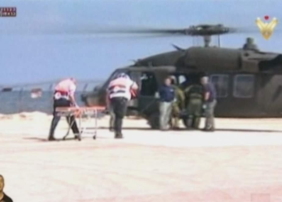 Israeli occupation soldiers evacuating troops during 2006 July War.jpg