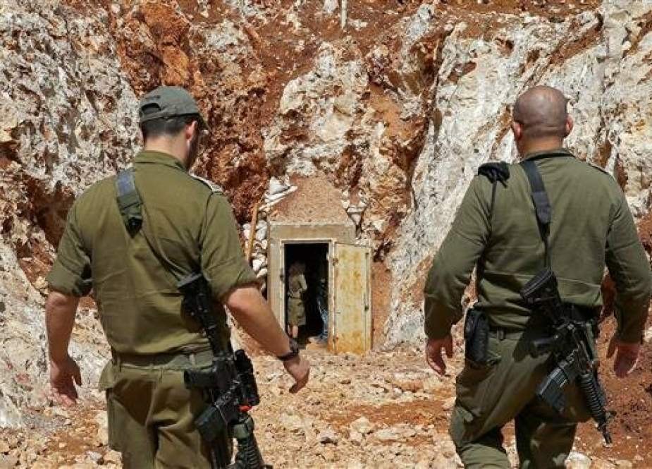 Israeli military soldiers walking near the entrance to a tunnel at the occupied territories