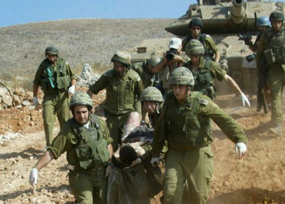 Israeli occupation forces evacuating injured soldiers following fierce clashes with Hezbollah fighters in south Lebanon.jpg