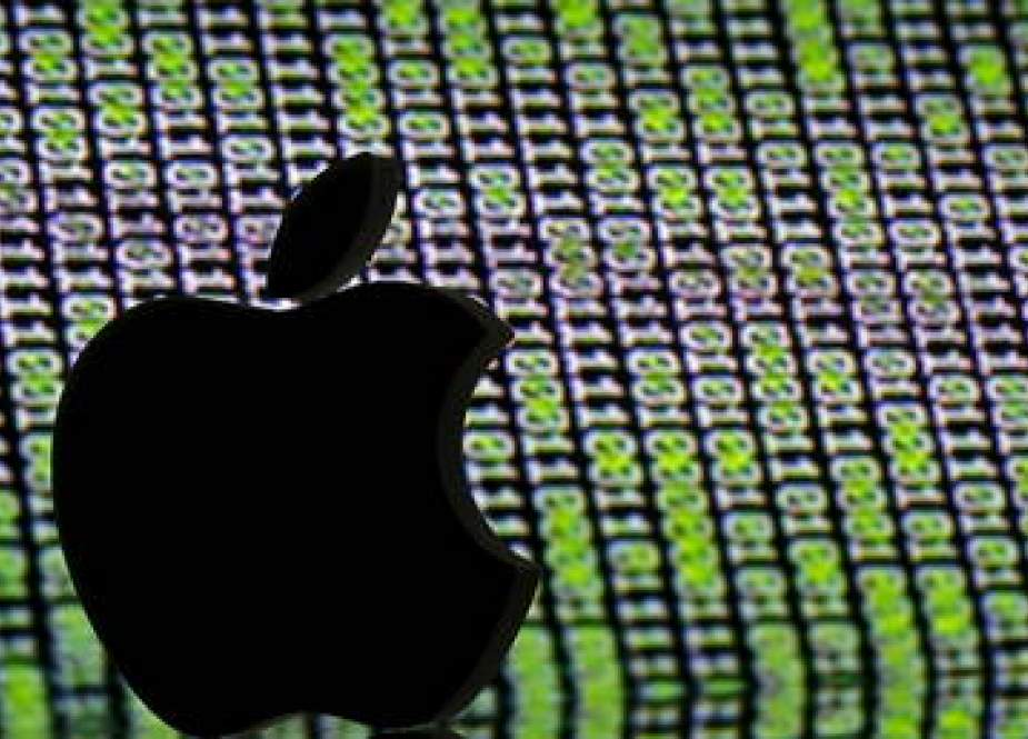 Apple logo, is seen in front of a displayed cyber code in this illustration.jpg