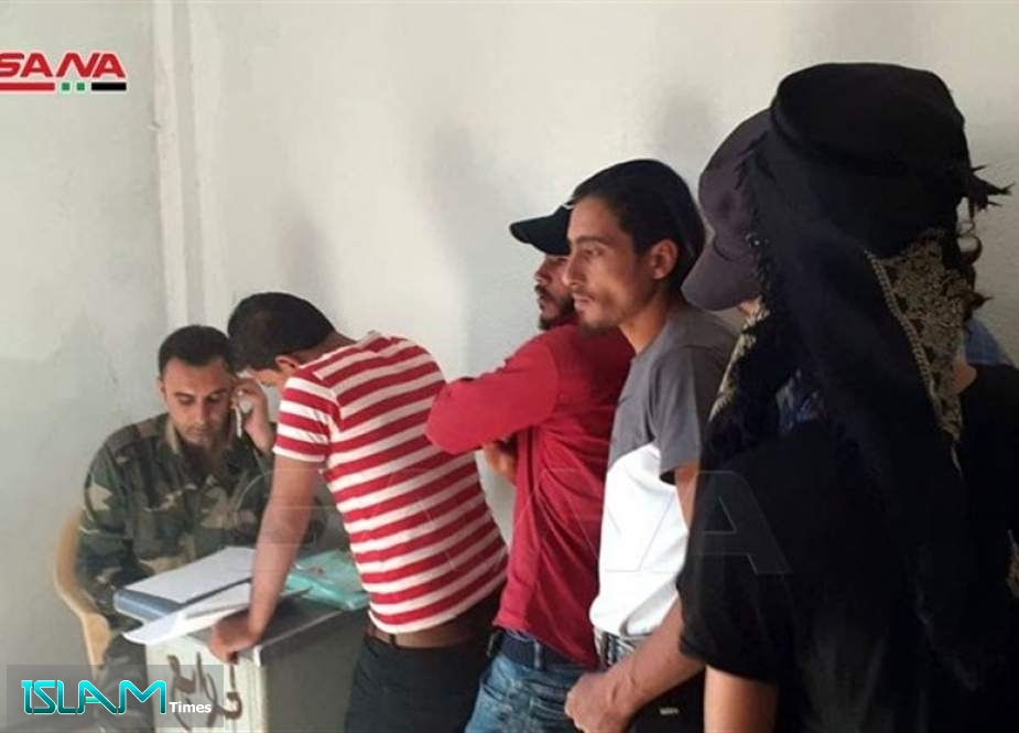 Dozens of Militants Surrender Arms to Syrian Authorities in Dara