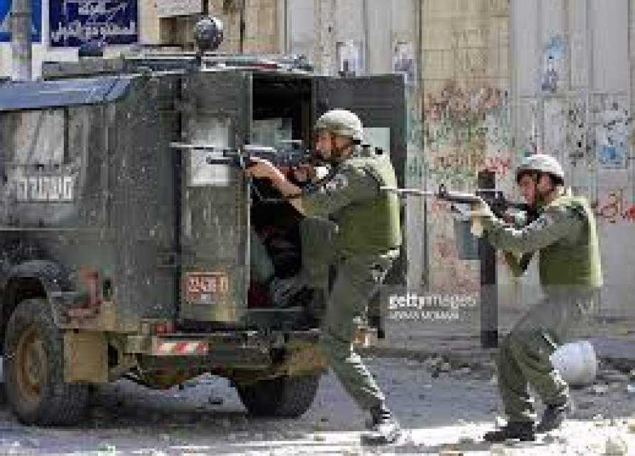 Israeli occupation forces shooting at Palestinians.jpg