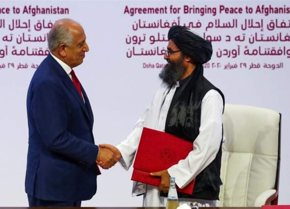 Zalmay Khalilzad, the US envoy for Afghanistan, and Mullah Abdul Ghani Baradar, the chief Taliban negotiator, in Qatar.jpg